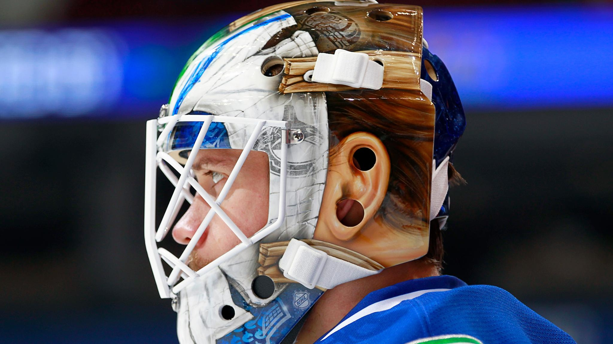 """Jacob Markstrom from the Vancouver Canucks showing off his modified """"Jason"""" mask"""