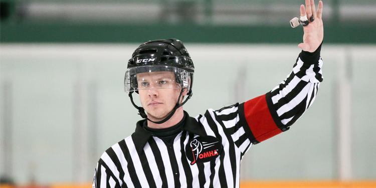 Ice hockey referee making a call